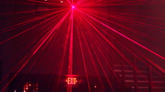 Night club lighting in action - 1 red and green laser ball - low angle up Stock Footage