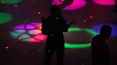 Night club scenes - silhouettes on a dance floor - 2 fun lighting high angle - stock footage