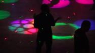Night club scenes - silhouettes on a dance floor - 2 fun lighting high angle Stock Footage