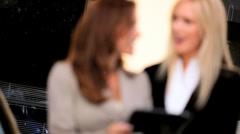 Smart Businesswomen with Wireless Tablet Stock Footage