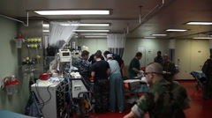 Doctors and Nurses Treat Patients in CASREC while underway to Port au Prince Stock Footage