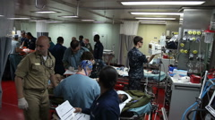 First Patients in CASREC on USNS Comfort on the way to Port au Prince, Haiti Stock Footage