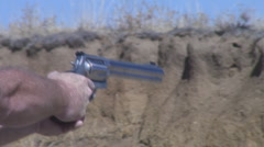 Firing a stainless steel 50 cal revolver Stock Footage