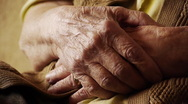 Senior old woman hand wrinkle skin close up Stock Footage