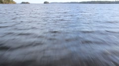A boat going across a lake. Stock Footage