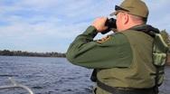 Coast guard surveys coastline (HD) k Stock Footage
