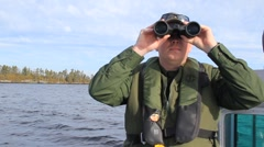 US Border Agent Looks Through Binoculars (HD) co Stock Footage