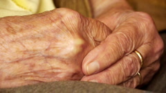 Senior old woman young man hold hand wrinkle skin close up   Stock Footage