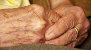 Stock Video Footage of Senior old woman young man hold hand wrinkle skin close up
