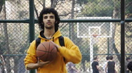 Young man play basketball ball turn on finger streetball sport game Stock Footage