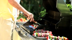 Seniors Using Barbeque Outdoors Stock Footage