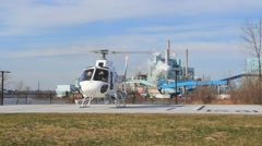 Helicopter on Landing Pad in Front of Power Plant (HD) co Stock Footage