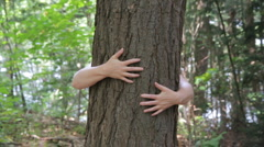 Hugging a tree. Stock Footage