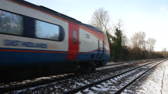East Midlands Meridian train in winter snow in Leicestershire England - stock footage