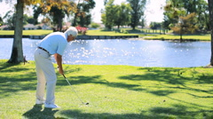 Retired Gentleman Learning to Play Golf Stock Footage