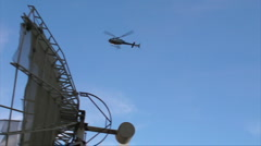 59 HD Helicopter flying fast over satelite dish w audio Stock Footage