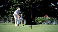 Seniors Golfing Lifestyle Stock Footage
