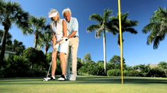 Senior Couple Practicing Golf   - stock footage