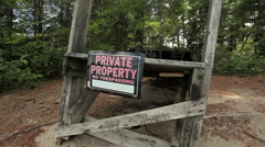 Private property sign on beach Stock Footage
