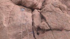Rock climbing ropes and anchors Stock Footage