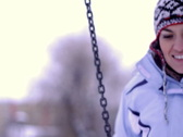 Happy woman on swing in winter time, dolly shot Stock Footage