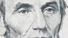 Abe Lincoln on US five dollar bill Stock Footage