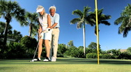 Seniors Learning to Play Golf Stock Footage