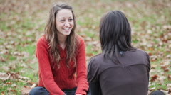 Two girls talking at the park Stock Footage