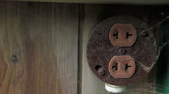 Old power outlet on wood wall Stock Footage