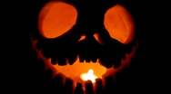 Candle burning in Halloween pumpkin Stock Footage