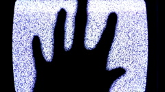Hand in front of static television screen Stock Footage