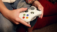 Young child playing Xbox 360 Stock Footage