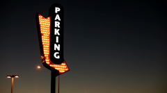 Parking Arrow sign on Night Sky Stock Footage