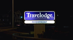 Riverfront Travelodge sign with traffic Stock Footage