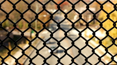 Traffic below seen through chain link fence Stock Footage