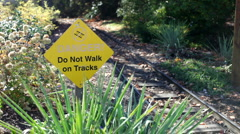 Danger Do Not Walk on Tracks sign Stock Footage