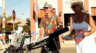 Traveling Keyboard player at Street Fair Stock Footage