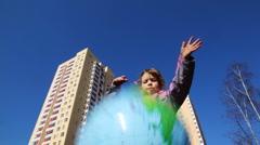 Girl throws big beach ball Stock Footage