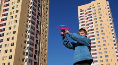 Boy runs up toy helicopter Stock Footage