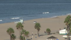 Santa Monica beach, w/ life guard trucks Stock Footage