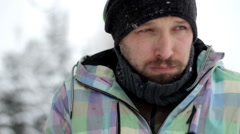 Young ill man coughing, outdoors, winter time Stock Footage