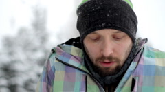 Sick man blowing his nose, outdoors, winter time Stock Footage