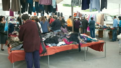 Women rummaging though clothes stall at Rethymnon market Crete Greece Stock Footage
