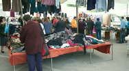 Stock Video Footage of Women rummaging though clothes stall at Rethymnon market Crete Greece