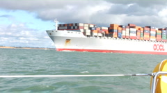 Container ship from yacht 01 Stock Footage