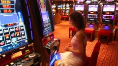 Woman at slot machine in play room in Persian Gulf. Stock Footage