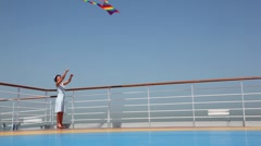 General view on woman flying kite on deck Stock Footage