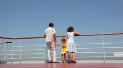 Bottom view on family walks on deck of ship Stock Footage