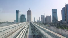 View on road from window of moving monorail train Stock Footage
