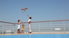 Family flying a kite on deck of ship Stock Footage